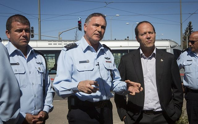Outgoing Chief of Police Yohanan Danino (center), Jerusalem District Police Commander Moshe Edri (left) and Jerusalem Mayor Nir Barkat (photo credit: Miriam Alster/Flash90)