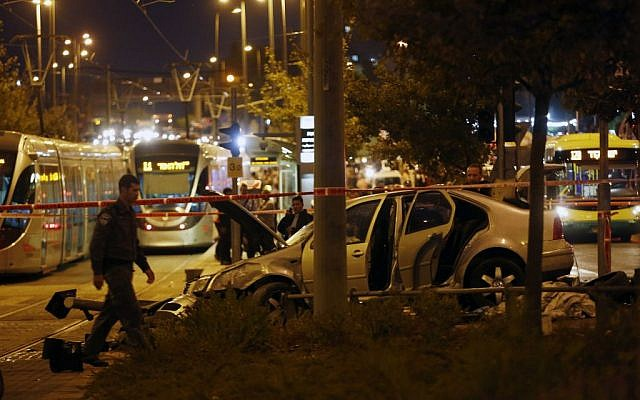 Police and rescue personnel at the scene where several people were injured when a car crashed into the Jerusalem light rail station on October 22, 2014. (Photo credit: Yonatan Sindel/Flash90)