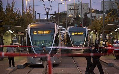 Police and rescue personnel at the scene where several people were injured when a car crashed into a Jerusalem Light Rail station, on October 22, 2014. (photo credit: Yonatan Sindel/Flash90)
