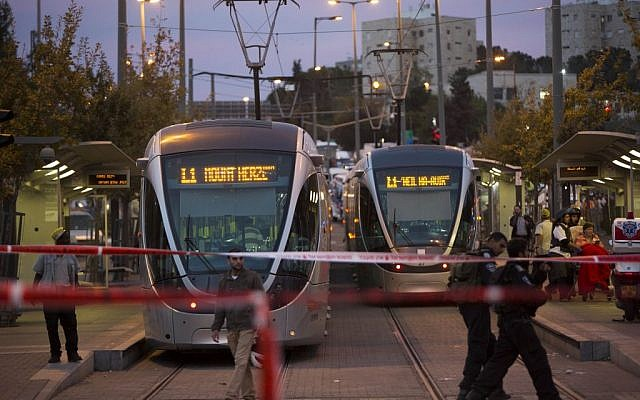 Police and rescue personnel at the scene where several people were injured when a car crashed into the Jerusalem light rail station in a terror attack, on October 22, 2014. (Photo credit: Yonatan Sindel/Flash90)
