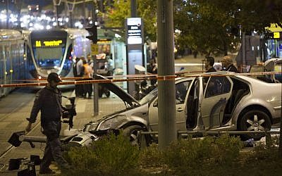 Police and rescue personnel at the scene where a baby was killed and several people were injured as a  Palestinian drove his car into the Jerusalem light rail station, by Ammunition Hill October 22, 2014. (Photo credit: Yonatan Sindel/Flash90)