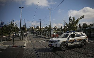 Security and police are seen at the Ammunition Hill Light Rail station in Jerusalem, where a baby was killed and several injured last night in a terror attack, Thursday, October 23, 2014. (photo credit: Hadas Parush/Flash90)