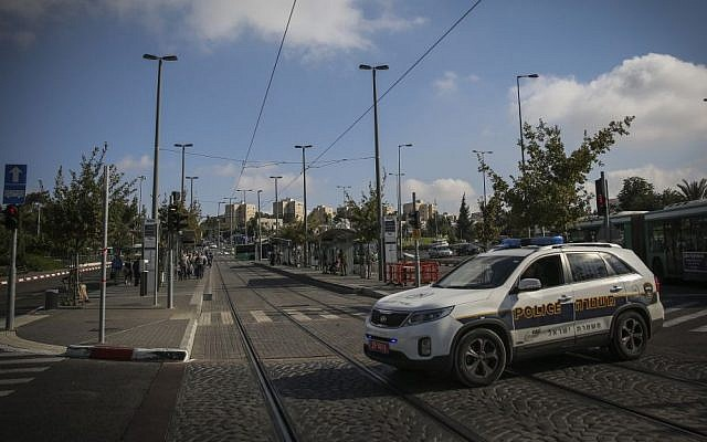 Illustration. Security and police are seen at the Ammunition Hill Light Rail station in Jerusalem, where a baby was killed and several injured last night in a terror attack, Thursday, October 23, 2014. (photo credit: Hadas Parush/Flash90)