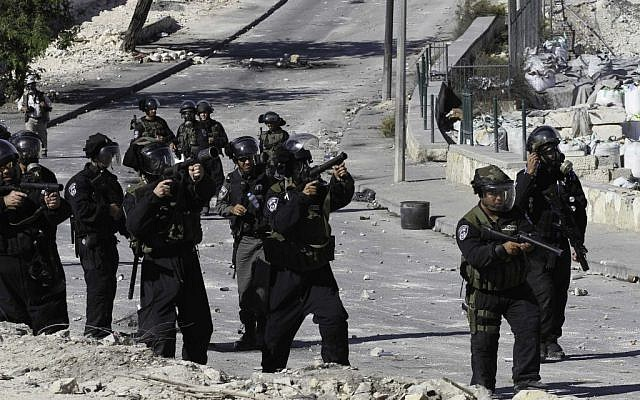 Israeli police shoot tear gas to disperse Palestinian youths throwing rocks in East Jerusalem, on October 24, 2014. (Photo credit: Sliman Khader/Flash90)