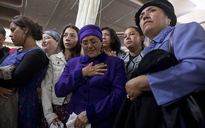 The mother of Ecuadorean Karen Yemima Muscara reacts during her daughter's funeral in Jerusalem, early Monday, October 27, 2014. (photo credit: Yonatan Sindel/Flash90)