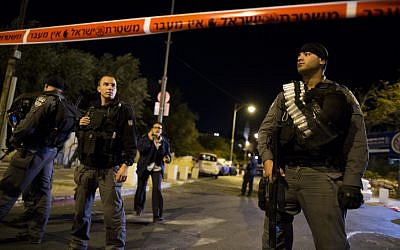 Israeli Police block off scene of shooting outside Jerusalem's Begin Heritage Center, where the leader of the Temple Mount Faithful was seriously injured on October 29, 2014. (photo credit: Yonatan Sindel/Flash90)