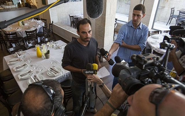 The owner of the Terasa restaurant, located at the Menachem Begin Center in Jerusalem, speaks to press on October 30, 2014, a day after the attempted assassination of Temple Mount Movement Leader, Yehudah Glick. (Photo  credit: Noam Revkin Fenton/Flash90)