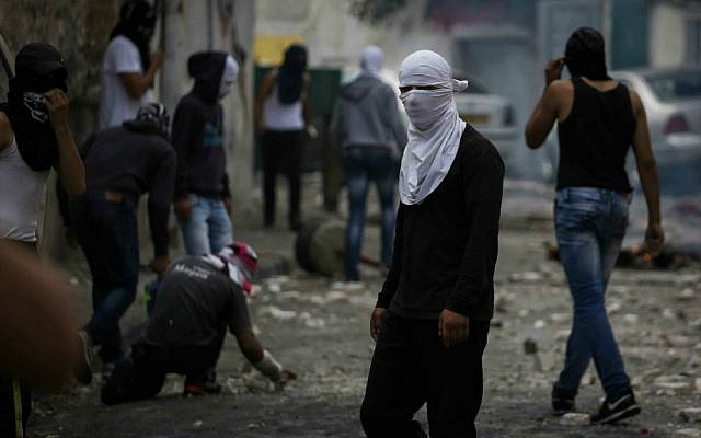 Palestinian youth clash with Israeli police in the Abu Tor neighborhood, October 30, 2014. (photo credit: Hadas Parush/Flash90)