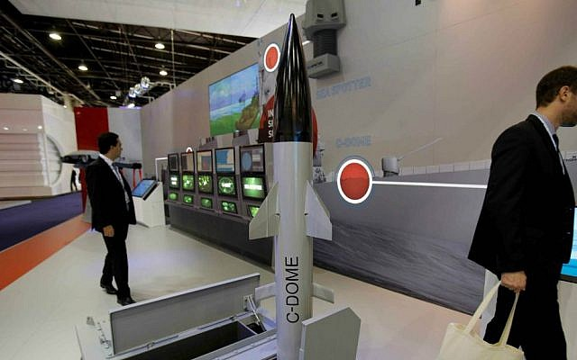 Visitors walk past a model of Rafael's C-Dome presented at the Euronaval show, in Le Bourget, north of Paris, Thursday, Oct. 30, 2014. (AP Photo/Christophe Ena)