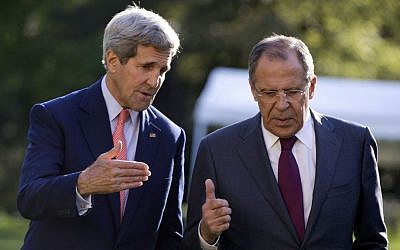 US Secretary of State John Kerry (left), and Russian Foreign Minister Sergey Lavrov talk as they walk together on the grounds of the Chief of Mission Residence in Paris, France, on October 14, 2014. (photo credit: AP/Carolyn Kaster, Pool)