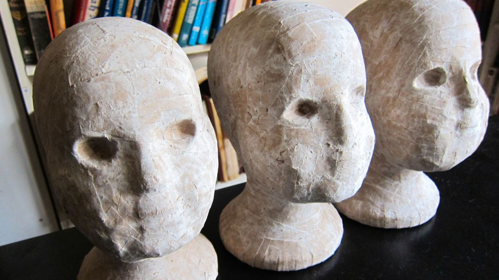 'Kinder,' three of 22 paper mache heads from Sara Erenthal's 'Be!' exhibit in New York.  (Credit: Cathryn J. Prince)