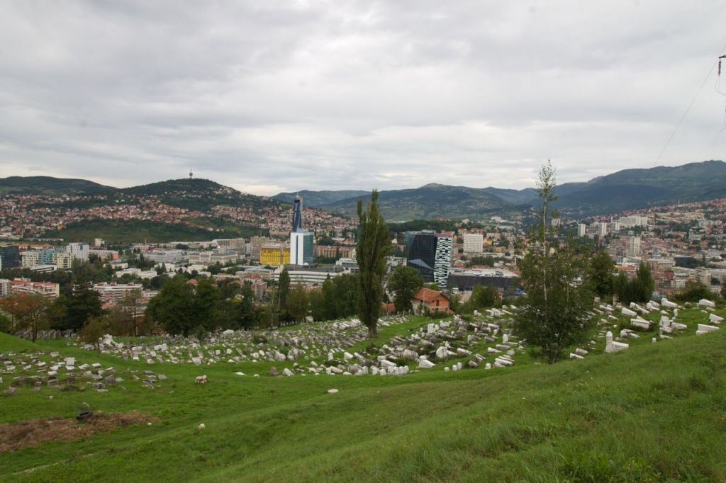 The Sarajevo Jewish cemetery, with the National Museum visible amid the trees to the left of the bright yellow Holiday Inn. (photo credit: Moti Tufeld)