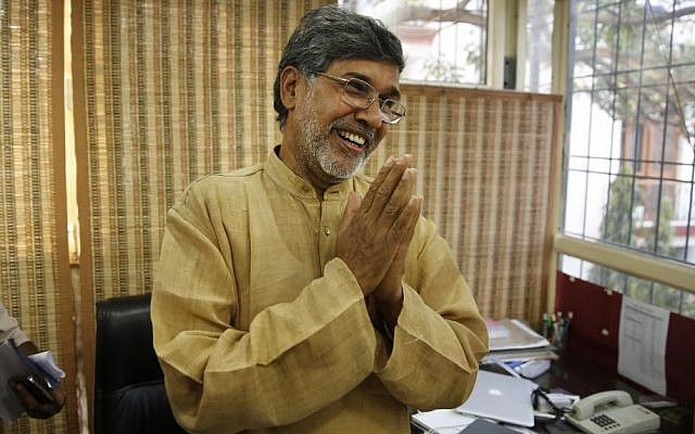 Indian children's rights activist Kailash Satyarthi gestures as he addresses the media at his office in New Delhi, India, Friday, Oct. 10, 2014. Malala Yousafzai of Pakistan and Satyarthi of India jointly won the Nobel Peace Prize on Friday, Oct. 10, 2014, for risking their lives to fight for children's rights. (photo credit: AP Photo/Manish Swarup)
