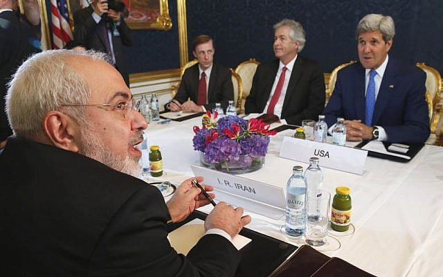 Iran's Foreign Minister Mohammad Javad Zarif, foreground left, holds a bilateral meeting with US Secretary of State John Kerry, background right, on the second day of talks, July 14, 2014, in Vienna, Austria. (photo credit: AP/Jim Bourg)