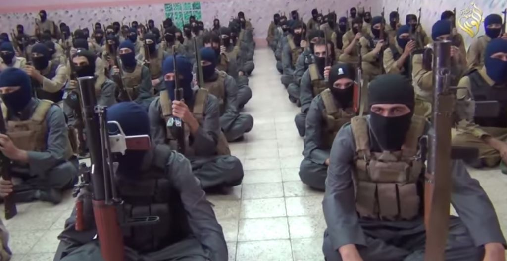 Still from a video of Islamic State fighters at a training camp in Iraq. The video was posted online on October 11, 2014. (screen capture: YouTube)