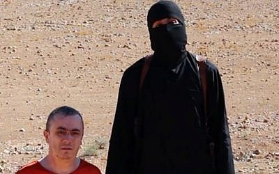 A frame from a video released Friday, Oct. 3, 2014, by Islamic State terrorists that shows the killing of British aid worker Alan Henning (photo credit: AP Photo)