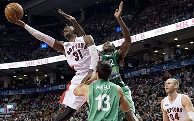 Toronto Raptors' Terrence Ross (31) drives against Maccabi Haifa's Jeff Allen (12) and Liraz Arieli (13) as Toronto's Greg Stiemsma, right, watches during the first half of an NBA exhibition basketball game Wednesday, Oct. 22, 2014, in Toronto. (AP Photo/The Canadian Press, Frank Gunn)