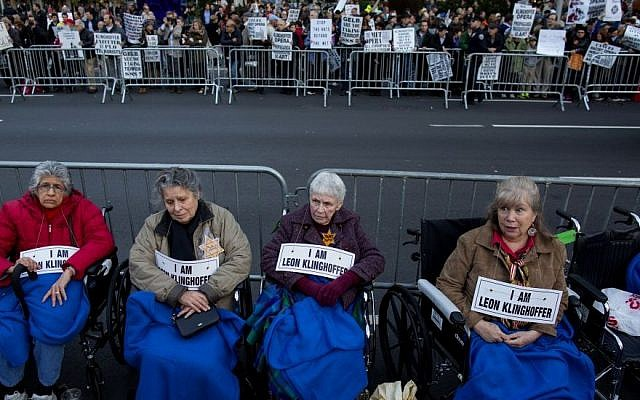 "People, some in wheelchairs, gather at Lincoln Center as they protest ""Death of Klinghoffer"" Monday, Oct 20, 2014, in New York. (Photo credit: AP/Craig Ruttle)"
