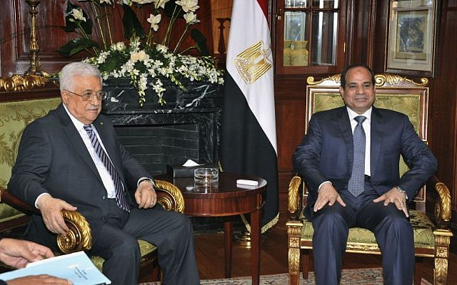 Palestinian Authority President Mahmoud Abbas, left, meets Egyptian President Abdel-Fattah el-Sissi in Cairo, Egypt, Sunday, Oct. 12, 2014 (AP Photo/Ahmed Foad, MENA)