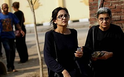 In this file photo taken Sunday, Oct. 26, 2014, Mona Seif, left, and her mother Laila Soueif, a university professor who is also an activist, stand outside a court that convicted 23 activists of staging an illegal demonstration and sentenced them each to three years in jail, in Cairo, Egypt. (AP Photo/Hussein Tallal, File)
