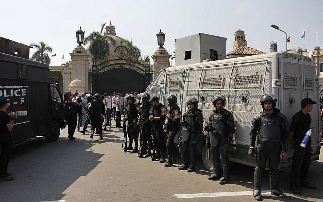 Egyptian security forces stand guard at Cairo University in Cairo, Egypt, on Sunday, October 12, 2014. (photo credit: AP Photo/El Shorouk, Aly Hazzaa)