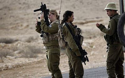 Israeli soldiers stand near the Israel and Egypt border on Wednesday, October 22, 2014. (photo credit: AP/Tsafrir Abayov)