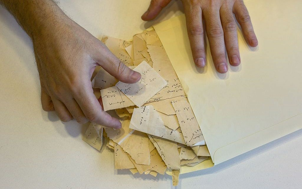 "Scraps from Israeli Nobel laureate S.Y. Agnon's masterpiece ""Shira"" at Israel's National Library in Jerusalem, October 2014. (photo credit: AP Photo/Sebastian Scheiner)"