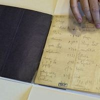 A library official shows celebrated author Franz Kafka's Hebrew vocabulary notebook at Israel's National Library in Jerusalem, October 2014. (AP Photo/Sebastian Scheiner)