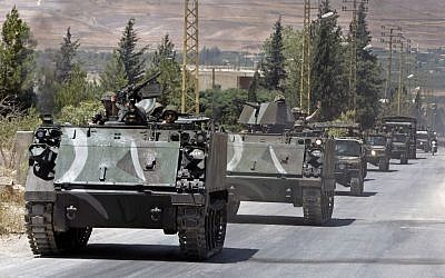 File: Lebanese Army reinforcements arrive at the outskirts of Arsal, a predominantly Sunni Muslim town near the Syrian border in eastern Lebanon, August 4, 2014. (AP/Bilal Hussein/File)
