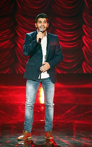 Haitham Khalaily, 24, performs during the Arab Idol Show broadcast by MBC Arabic satellite channel in Zouk Mosbeh neighborhood, north of Beirut, Lebanon. (photo credit: AP Photo/MBC Press Office)