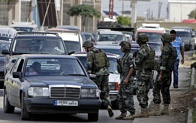 Illustrative: Lebanese army soldiers inspect a vehicle at a checkpoint on a road, in the northern port city of Tripoli, Lebanon, Monday, Oct. 27, 2014. (AP Photo/Bilal Hussein)