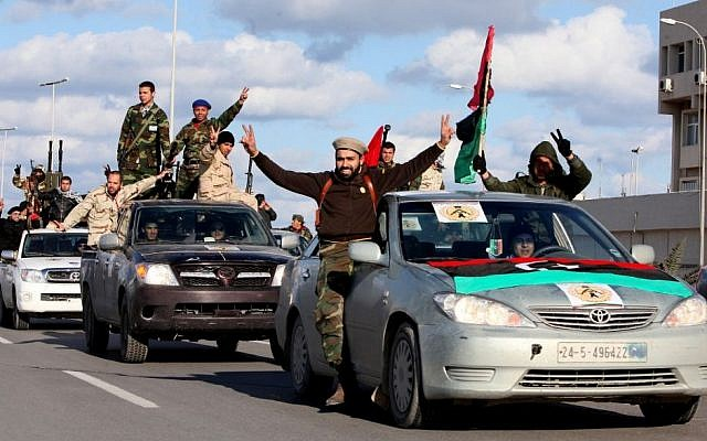 In this Tuesday, Feb. 14, 2012 file photo, Libyan militias from towns throughout the country's west parade through Tripoli, Libya. (Photo credit: AP/Abdel Magid Al Fergany, File)