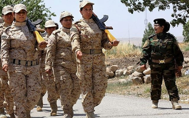 In this Thursday, July 3, 2014 file photo, an elite unit of women Kurdish Peshmerga fighters trains in Sulaimaniyah, 160 miles (260 kilometers) northeast of Baghdad, Iraq. (Photo credit: AP)