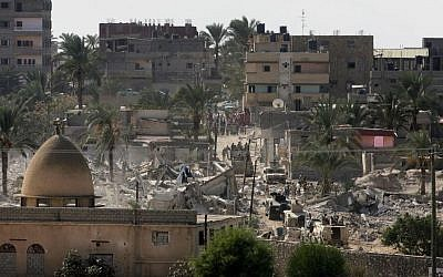 Egyptian security forces secure houses which were destroyed by the Egyptian army on the Egyptian side of the border town of Rafah, Wednesday, Oct. 29, 2014. (Photo credit: AP/Eyad Baba)