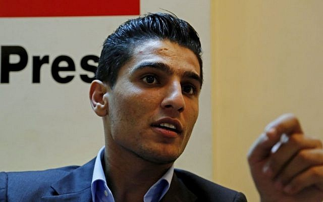 Mohammed Assaf, a 24-year-old Palestinian who won the 2013 TV singing contest Arab Idol, talks during an interview at The Associated Press office in Gaza City in the northern Gaza Strip, Wednesday, Oct. 22, 2014. (photo credit: AP/Adel Hana)