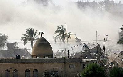 Smoke rises after the Egyptian army demolished houses on the Egyptian side on the border town of Rafah, Wednesday, Oct. 29, 2014. (Photo credit: AP /Eyad Baba)