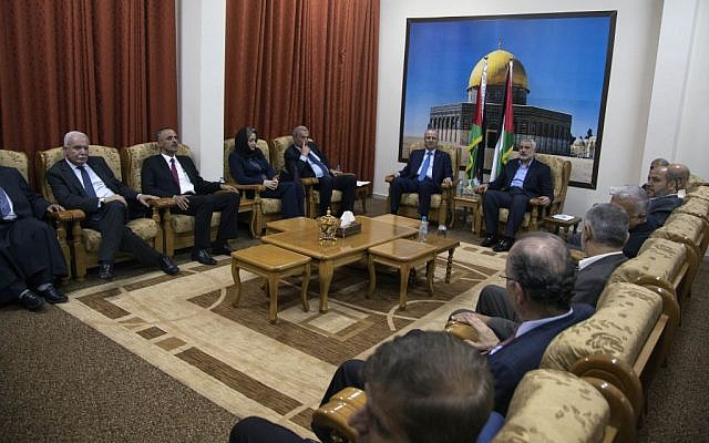 Palestinian Authority Prime Minister Rami Hamdallah and the ministers of Palestinian unity government meet with top Hamas leader in Gaza, Ismail Haniyeh, in Gaza City, Thursday, Oct. 9, 2014 (photo credit: AP Photo/Khalil Hamra)