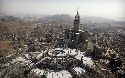 The tallest clock tower in the world at the Abraj al-Bait Towers overlooks the Grand Mosque and its expansion in Mecca, Saudi Arabia, October 16, 2013. (photo credit: AP/Amr Nabil, File)