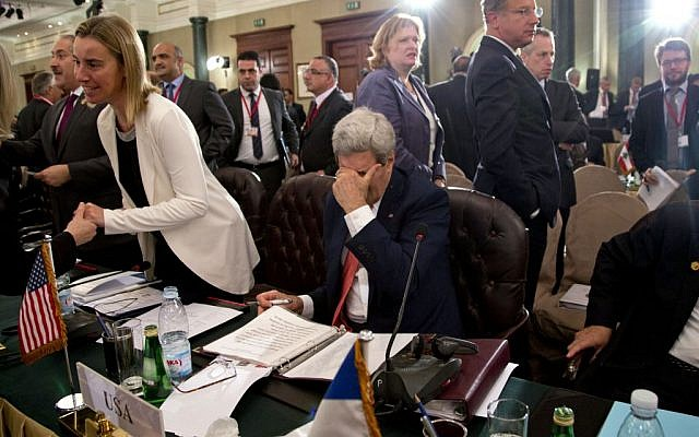 U.S Secretary of State John Kerry pauses to rub his face, in Cairo, Egypt, Sunday, Oct. 12, 2014, during the Gaza Donor Conference. (photo credit: AP Photo/Carolyn Aster, Pool)