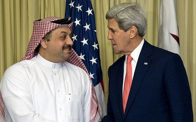 US Secretary of State John Kerry shakes hands with Qatari Foreign Minister Khalid bin Mohammad al-Attiyah in Cairo, Egypt, on Sunday, October 12, 2014, during the Gaza donor conference. (photo credit: AP/Carolyn Kaster, Pool)