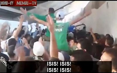 Screen capture from a video clip showing  fans of the Raja Club Athletic from Casablanca, Morocco cheering for the Islamic State. (screen capture:YouTube/MEMRITVvideos)