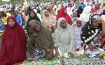 Nigeria Muslims offer Eid al-Adha prayers in Lagos, Nigeria, Saturday, Oct. 4, 2014. Muslims around the world will celebrate Eid al-Adha, the Festival of Sacrifice, to mark the end of the hajj pilgrimage by slaughtering sheep, goats, cows and camels to commemorate Prophet Abraham's readiness to sacrifice his son Ismail on God's command. (photo credit: AP Photo/Sunday Alamba)