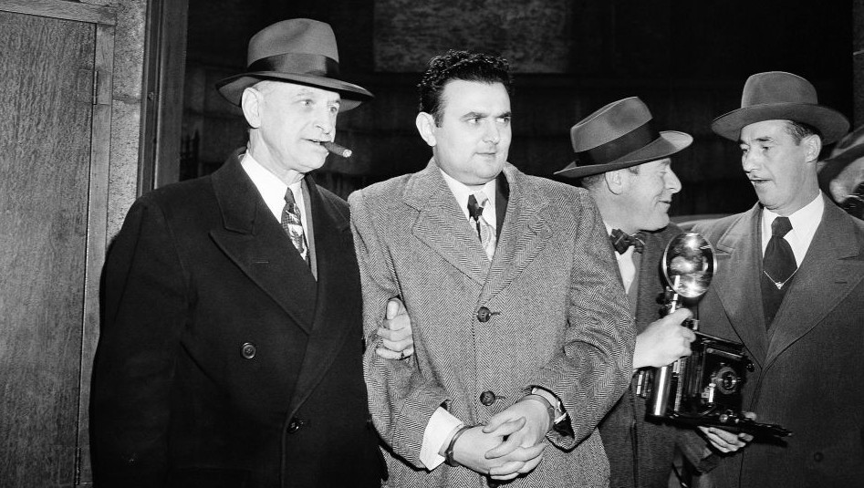In this April 5, 1951, file photo, David Greenglass, second from left, is led into Federal Courthouse in New York for sentencing as an atom spy. (Photo credit: AP Photo/File)