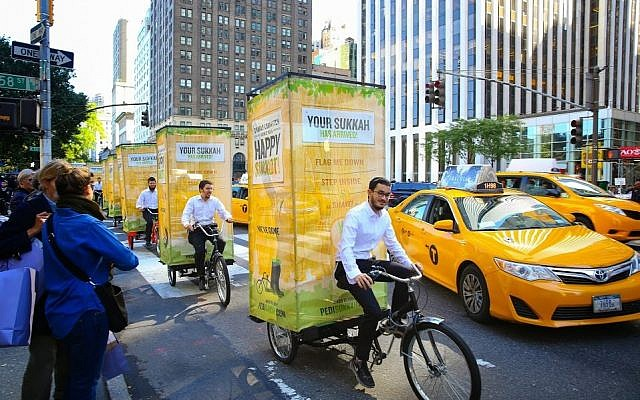A fleet of pedi-sukkahs cruise through New York City. (Photo credit: Chabad.org / JTA)