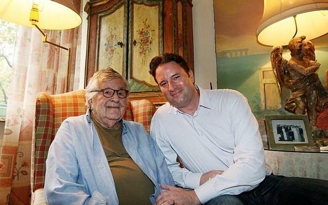 In this photo taken on Tuesday, Oct. 14, 2014, Gene Gutowski, left, who produced four of Roman Polanski's films, poses with his son Adam Bardach at his home in Warsaw, Poland. (AP Photo/Czarek Sokolowski)