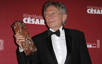Polish-French film director Roman Polanski holds his best director award during the 39th French Cesar Awards Ceremony in Paris, Friday Feb. 28, 2014. (photo credit: AP/Lionel Cironneau, File)