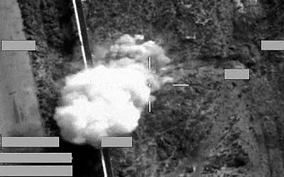 A handout picture received from Britain's Ministry of Defense on September 30, 2014 shows a screen shot of a strike on an Islamic State armed pick-up truck, using a Brimstone missile, in an undisclosed location in Iraq during an armed mission in support of Op Shader. (photo credit: AFP PHOTO/CROWN)