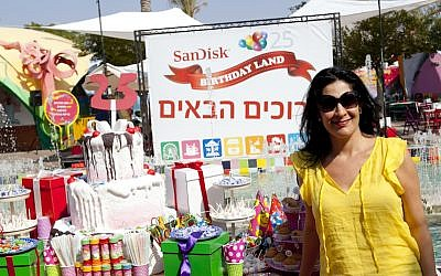 Ronit Karpel, SanDisk's Director of Personnel for Israel and the EMEA region, poses at Israel's Superland amusement park, where the company threw a 25th anniversary party for employees and their families last year (Photo credit: Courtesy)