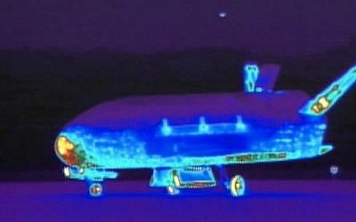 This June 16, 2012 file image from video made available by the Vandenberg Air Force Base shows an infrared view of the X-37B unmanned spacecraft landing at Vandenberg Air Force Base. (AP Photo/Vandenberg Air Force Base)