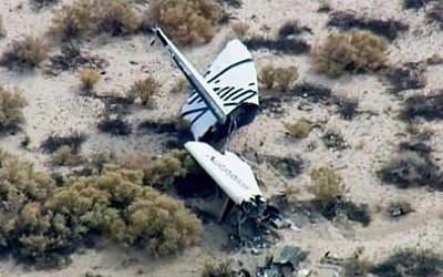 This image from video by KABC TV Los Angeles shows wreckage of what is believed to be SpaceShipTwo in Southern California's Mojave Desert on Friday, Oct. 31, 2014. A Virgin Galactic space tourism rocket exploded after taking off on a test flight, a witness said Friday. (photo credit: AP Photo/KABC TV)